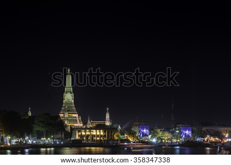 Old pagoda with colorful lighting near waterside during New Year Celebrate