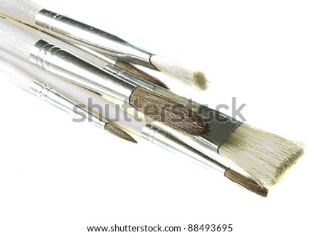old paint brushes isolated on a white background