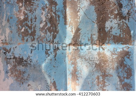 old paint on the concrete fence