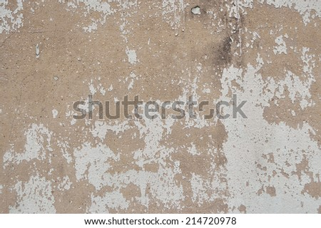Old paint peeling from wall texture background - stock photo
