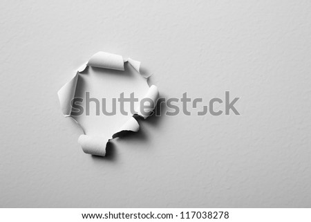 old paint peeling off the wall - round shaped hole - stock photo