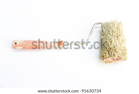 Old paint roller - stock photo