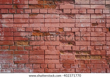 Old painted wall of red brick - stock photo