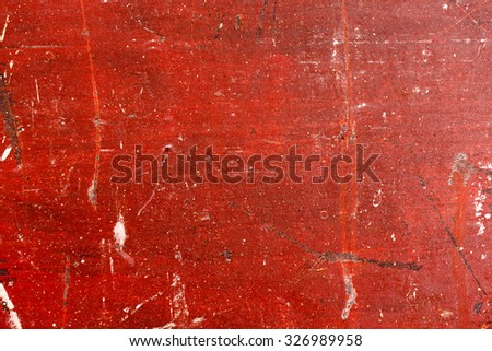 Old painted wood with chipped red paint. Grunge style background. - stock photo