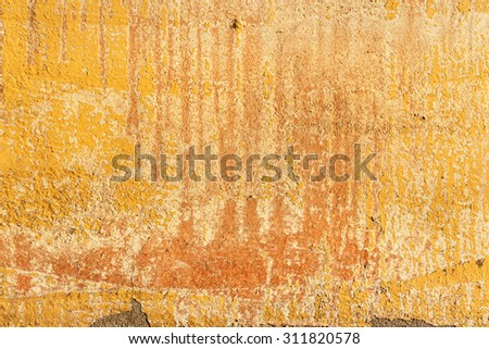 Old painted yellow wall fragment