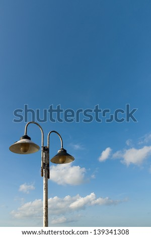 Old pair iron lamp on Pole Blue Sky and White Cloud