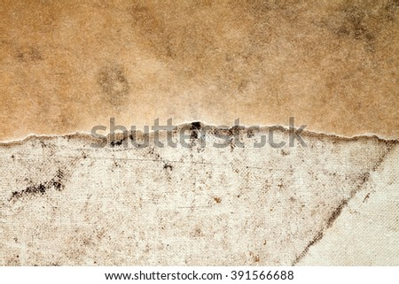 Old paper and dirty canvas - perfect background with copy-space