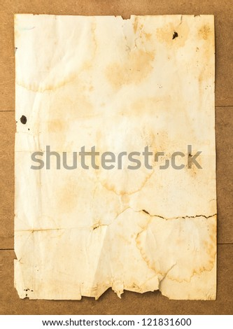 old paper background on wood - stock photo