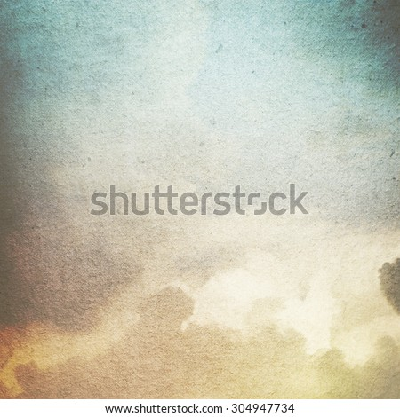 old paper grunge background with abstract canvas texture white clouds and blue sky view - stock photo