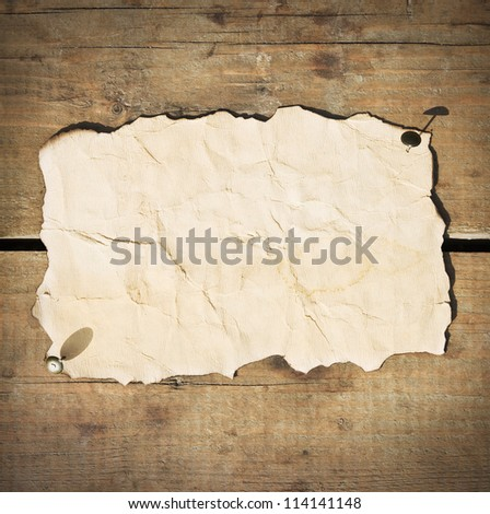 old paper hanging on the wooden fence - stock photo