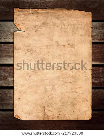Old paper on brown wood texture, horizontal slats from a weathered bench  - stock photo