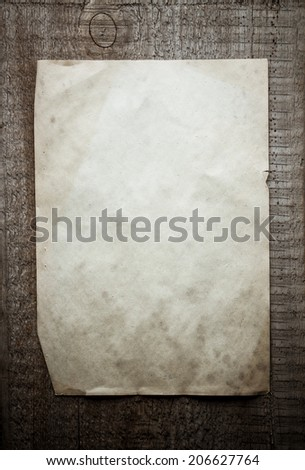 old paper on dirty wooden background