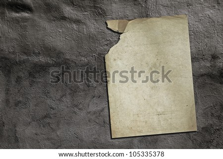 old paper on grey dirty wall