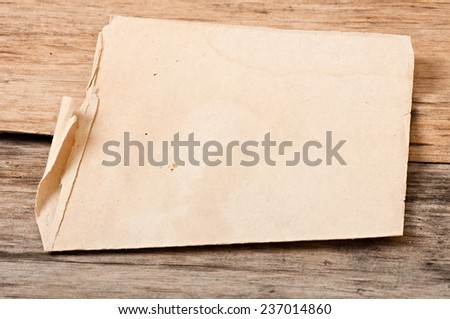 old paper on old wooden background