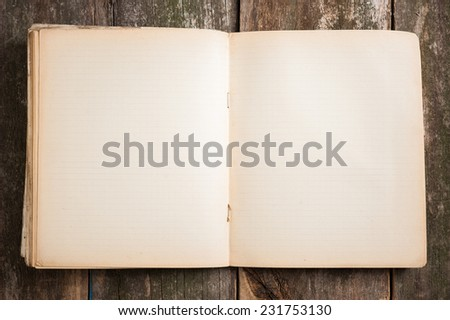 Old paper open aged blank exercise book notebook on wooden background - stock photo