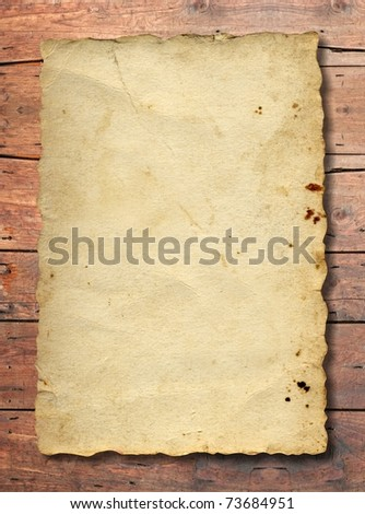 Old paper over an old wood background, ideal for vintage and grungy designs and concepts