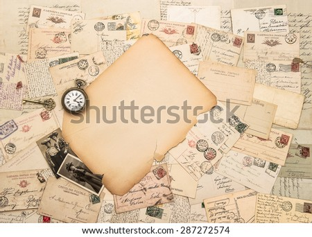 Old paper piece, antique accessories and postcards. Sentimental vintage background - stock photo