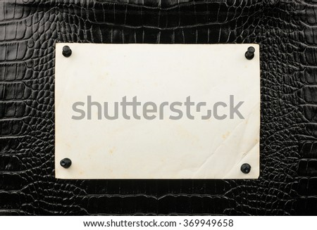 Old paper pin up  pushpin to the crocodile skin, with space for your text - stock photo