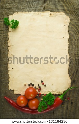 old paper sheet and vegetables for a menu or recipe - stock photo