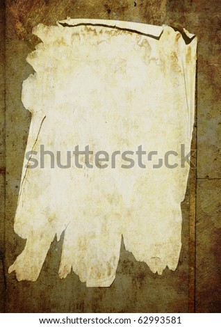 Old paper sheet stick on street wall - stock photo