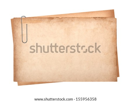 old paper with clip isolated on white - stock photo