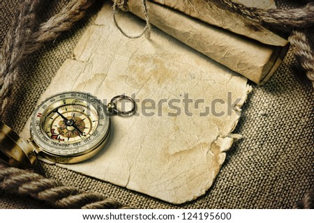 old paper with compass and rope on canvas