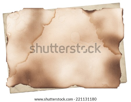 Old paper with damaged and burned edges - stock photo
