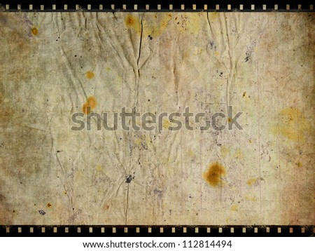 Old paper with film strip background - stock photo