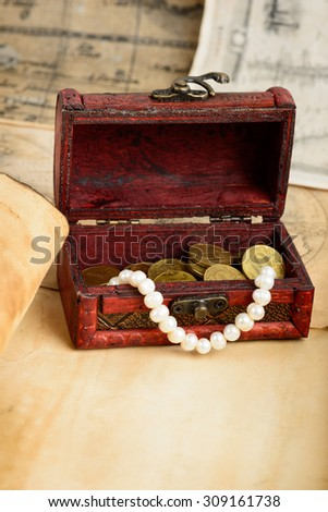 old paper with vintage chest - stock photo