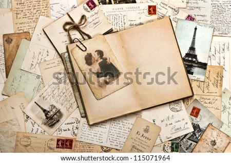 old papers, french post cards and open diary book. romantic vintage background - stock photo