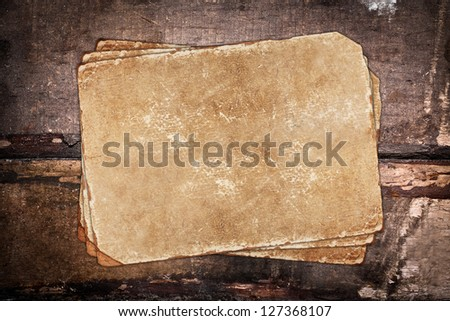 Old papers on a dark wooden background