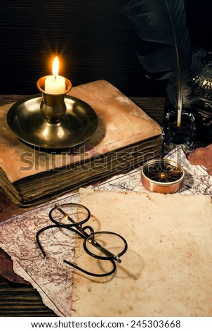 old papers on a wooden table - stock photo