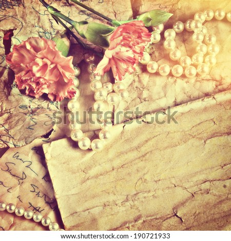 old papers, pearls and flowers
