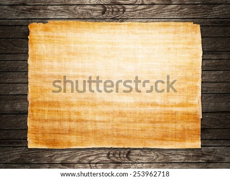 old papyrus paper on wooden background