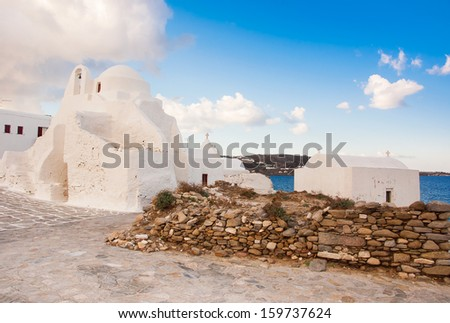 Old Paraportiani 14 century church in the clouds on the island Mykonos in Greece - stock photo