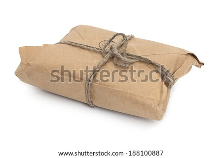 Old parcel  tied with a string, isolated on white background