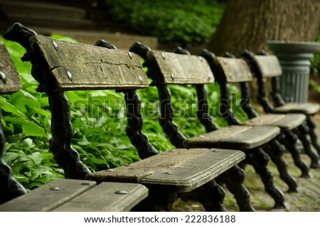 Old park bench close-up - stock photo