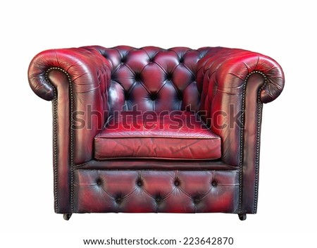 Old partially damaged red leather armchair on a white background - stock photo