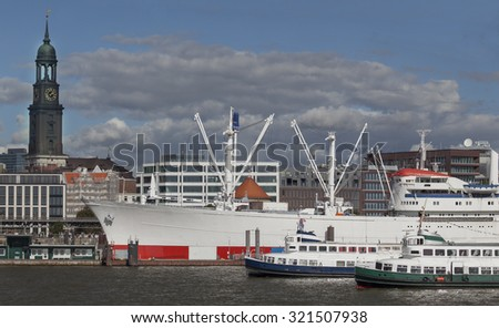 Old passenger ships on the river Elbe in Hamburg, Germany - stock photo