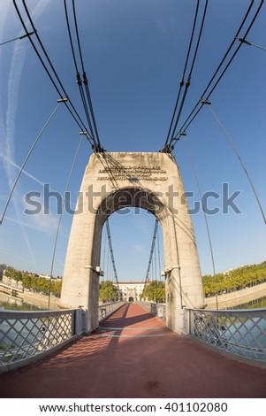 Old Passerelle du College bridge over Rhone river in Lyon, France (Fisheye Lens) - stock photo