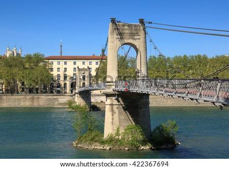 Old Passerelle du College bridge over Rhone river in Lyon, France, on a spring day. - stock photo