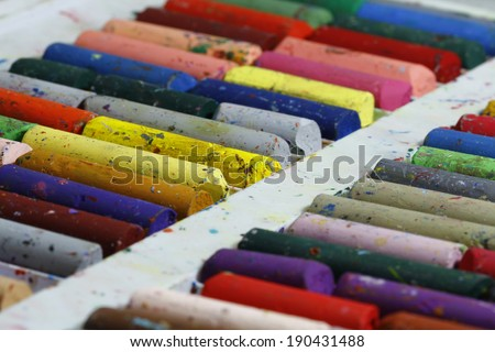 Old pastel colorful crayons - stock photo