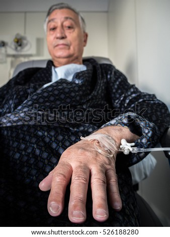 Old patient man with iv drip in the hand. Hand close-up detail