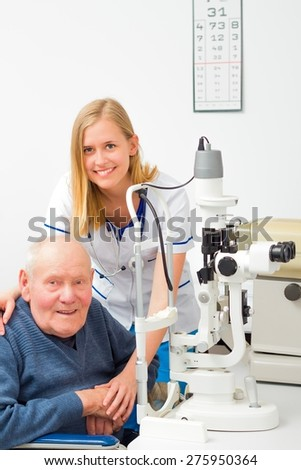 Old patient needing help at the optometrist's. - stock photo
