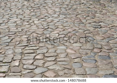 Old pavement street in Poland. - stock photo