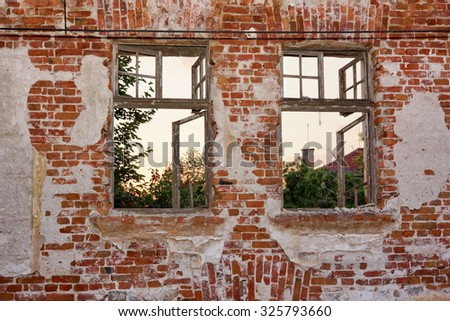 Old Peeled Lonely Brick Wall With Two Broken Wood Windows Frame - stock photo
