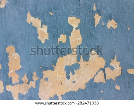 Old peeling paint and dirty on old blue concrete wall background