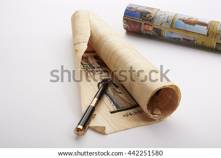 old pen and papyrus tube - stock photo