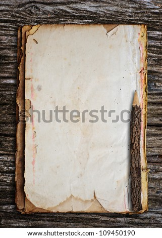 Old pencil put on old paper. - stock photo