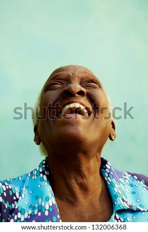 Old people and emotions, portrait of bizarre senior african american lady laughing with head tilted up. Copy space - stock photo